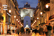 The grand Arch of Rua Augusta, with the statue of king José I in the background. This street, closed to the traffic, is the busiest of Baixa district, in central Lisbon.