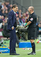 Football - 2016 / 2017 Premier League - West Ham United vs. Sunderland<br /> <br /> West Ham Manager Slaven Bilic gets a talking to from referee Bobby Madley at The London Stadium.<br /> <br /> COLORSPORT/DANIEL BEARHAM