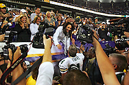 Green Bay Packers' Brett Favre meets his wife Deanna Favre after the Packers beat the Vikings 23-16..The Green Bay Packers traveled to the Metrodome in Minneapolis to play the Vikings Sunday September 30, 2007. Steve Apps-State Journal.