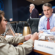"""Timothy Roemer speaks with a reporter during a break between panels. The 9/11 Commission's 12th public hearing on """"The 9/11 Plot"""" and """"National Crisis Management"""" was held June 16-17, 2004, in Washington, DC."""