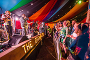A band plays to an enthusiastic crowd in the Open Arms - The 2019 Glastonbury Festival, Worthy Farm. Glastonbury.