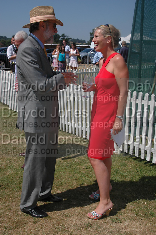 Viscount Cowdray and Sally Gilbert. Veuve Clicquot Gold Cup Final at Cowdray Park. Midhurst. 17 July 2005. ONE TIME USE ONLY - DO NOT ARCHIVE  © Copyright Photograph by Dafydd Jones 66 Stockwell Park Rd. London SW9 0DA Tel 020 7733 0108 www.dafjones.com