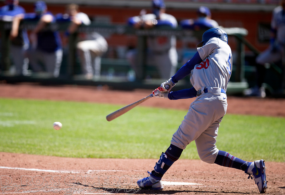 Los Angeles Dodgers' Mookie Betts (50) connects for a single against the San Francisco Giants during the sixth inning of a baseball game on Thursday, Aug. 27, 2020 in San Francisco, Calif. (D. Ross Cameron/SF Chronicle)