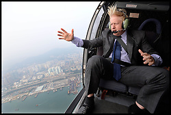 London Mayor Boris Johnson takes a helicopter ride over Hong Kong as he arrive in the City on Day 5 of a  trade mission to China on his 6 day visit to  China. Thursday, 17th October 2013. Picture by Andrew Parsons / i-Images/ POOL