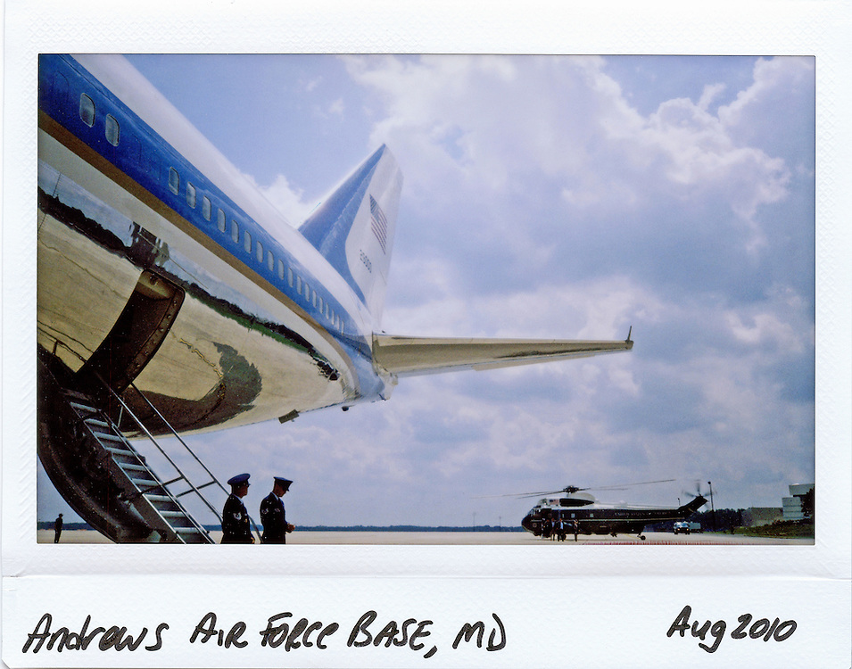Air Force personnel stand the at the foot of Air Force One as they wait for the arrival of U.S. President Barack Obama at Andrews Air Force Base near Washington, August 19, 2010