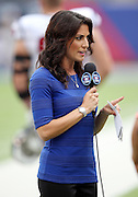 CBS Sports sideline reporter Jenny Dell reports from the sideline during the New York Giants NFL week 3 regular season football game against the Houston Texans on Sunday, Sept. 21, 2014 in East Rutherford, N.J. The Giants won the game 30-17. ©Paul Anthony Spinelli