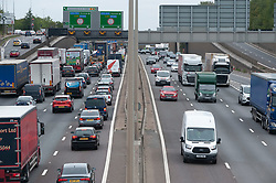 ©Licensed to London News Pictures 27/08/2020 Dartford,UK. The big August bank holiday staycation getaway has started early today on the M25 motorway in Dartford, Kent. Traffic near the Dartford crossing is at a near standstill anti clock-wise this afternoon as bank holiday travellers look to beat the travel chaos with 18 million cars expected on the roads this weekend as well as rail cancellations due to engineering works causing delays. Photo credit: Grant Falvey/LNP