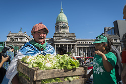 April 17, 2018 - Buenos Aires, Argentina.- Small farmers and family farmers give away in front of the National Congress, City of Buenos Aires, 30 thousands kilos of vegetables in favor of the law project that allows them access to their own land. (Credit Image: © Julieta Ferrario via ZUMA Wire)