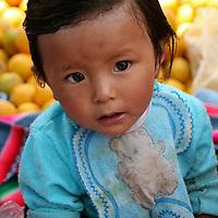 Americas, South America, Peru, Pisac. Market baby.