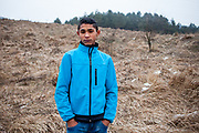 """Portrait of Patrick (15) who is one of the young residents at the Roma part of the district """"Podsadek"""", located in a little valley. The city of Stara Lubovna is located about 100 km from Kosice in northeast Slovakia. The town has a population of 16350, of whom 2 060 (13%) are of Roma origin. The majority of Roma live in the Podsadek district, where 980 (74%) out of 1330 inhabitants are Roma."""