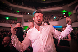 """© Licensed to London News Pictures . 05/02/2016 . Manchester , UK . Audience member . """" Hacienda Classical """" debut at the Bridgewater Hall . The 70 piece Manchester Camerata and performers including New Order's Peter Hook , Shaun Ryder , Rowetta Idah , Bez and Hacienda DJs Graeme Park and Mike Pickering mixing live compositions . Photo credit : Joel Goodman/LNP"""