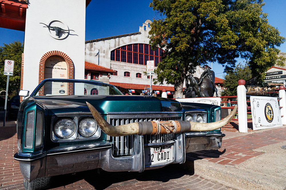 Cadillac convertible with Texas Longhorn mounted on bumperg, Fort Worth Stockyards, Fort Worth Texas, USA.