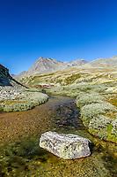 River and Rondvasssbu tourist hut, turisthytte, Rondane National Park, Norway - August