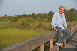 Mature man smiling outdoors on a dock