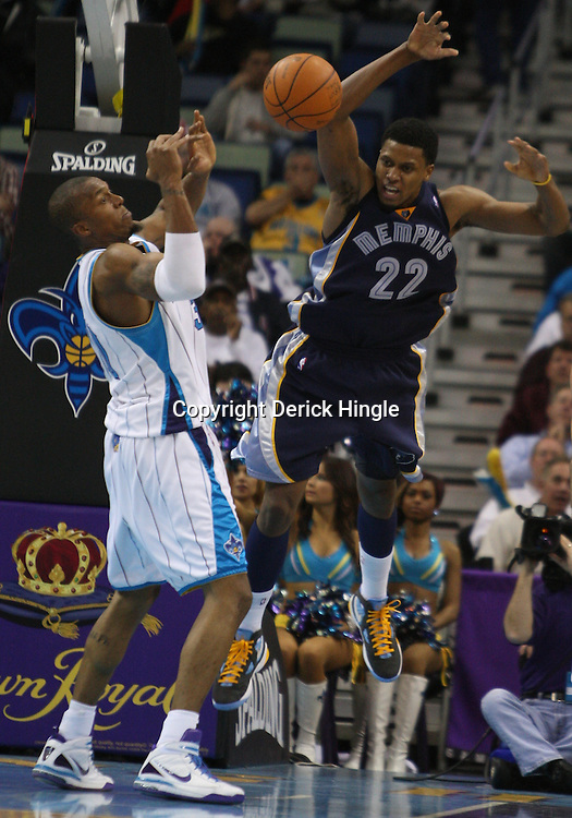 Mar 03, 2010; New Orleans, LA, USA; New Orleans Hornets forward David West (30) knocks the ball away from Memphis Grizzlies forward Rudy Gay (22)during the second half at the New Orleans Arena. The Grizzlies defeated the Hornets 104-100. Mandatory Credit: Derick E. Hingle-US PRESSWIRE