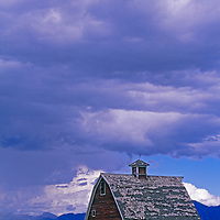 An old barn rises in a Gallatin Valley pasture under the Bridger Mountains.