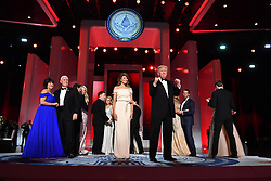President Donald Trump and First Lady Melania Trump appear along with family members and Vice President Mike Pence and his wife Karen Pence at the Liberty Ball at the Washington Convention Center on January 20, 2017 in Washington, D.C. Trump will attend a series of balls to cap his Inauguration day. Photo by Kevin Dietsch/UPI