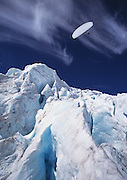 A motorized paraglider flies over the glaciers of Mt. Aspiring, in the New Zealand Alps, South Island, New Zealand