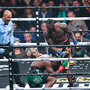 Deontay Wilder (R) sends Luis Ortiz to the canvas during the WBC Heavyweight Championship boxing match at Barclays Center on Saturday, March 3, 2018 in Brooklyn, New York. Wilder would win the bout by knockout in the tenth round to retain the title and move to 40-0. (Alex Menendez via AP)