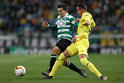 February 14, 2019 - Lisbon, Portugal - Marcos Acuña of Sporting CP (L) vies for the ball with Ramiro Funes Mori of Villarreal FC (R) during the Europa League 2018/2019 footballl match between Sporting CP vs Villarreal FC. (Credit Image: © David Martins/SOPA Images via ZUMA Wire)