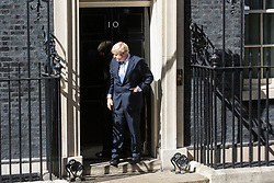 London, UK. 24 July, 2019. Boris Johnson enters 10 Downing Street for the first time as Prime Minister after having been formally appointed by the Queen at Buckingham Palace.