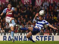 Photo. Daniel Hambury.<br />Carling Cup.<br />22/09/2004.<br />Aston Villa V Queens Park Rangers. <br />Aston Villa's Gareth Barry's shot beats QPR's Kevin McLeod but misses.