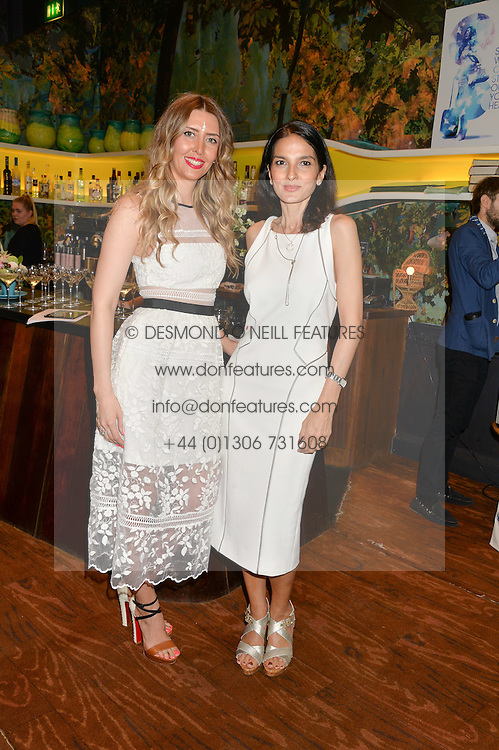 Left to right, ANNA GRACE-DAVIDSON and YASMIN MILLS at a tea party to launch Grace Guru held at Sketch, 9 Conduit Street, London on 17th June 2015.