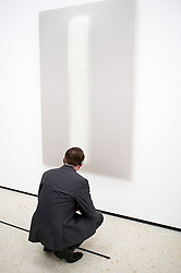 Visitor looking at painting Stylite II by Gotthard Graubner at Stadel museum in Frankfurt Germany