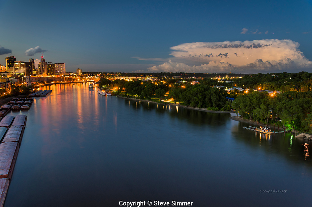 After a very active sky over St. Paul, by sundown there only one cloud left - but it was a big one. Look closely for the lightning bolts in this thunderhead.