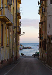 Sorrento, Italy, September 16 2017. Marina Grande in Sorrento, Italy is glimpsed at dawn from between traditional buildings. © Paul Davey