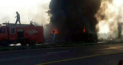June 25, 2017 - Ahmed Pur Sharqia, Punjab, Pakistan - (Cell Phone Captured Pics) At least 146 people were killed and scores injured in a fire that broke out after an oil tanker overturned in Ahmad Pur Sharqia area of Bahawalpur, Pakistan. Crowds rushed to collect fuel, an official said. According to media reports, the accident occurred after dozens of people from nearby localities gathered to collect oil from the overturned tanker when it blew up. At least 75 motorbikes and six cars passing by also burnt by blaze. (Credit Image: © Rana Sajid Hussain/Pacific Press via ZUMA Wire)