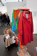 Mother shows her daughter an artwork. Visitors and exhibitors at the many galleries exhibiting at the Frieze Art Fair 2012. This art fair is for work at the high end of international contemporary art with many well known artists on show from many of the world's most reknowned dealers.