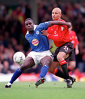 Ade Akinbiyi (Leicester) holds off Wes Brown (Man Utd). Leicester City v Manchester United. FA Premiership, 14/10/00. Credit: Colorsport / Andrew Cowie.