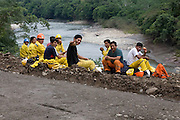 Road construction workers reasting for lunch adjacent to the Interoceanic Highway in the Amazon.