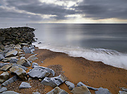 UK Coastline Moody sky and surf break on rocky beach in Southwest England.  Licensing and Open Edition Prints.