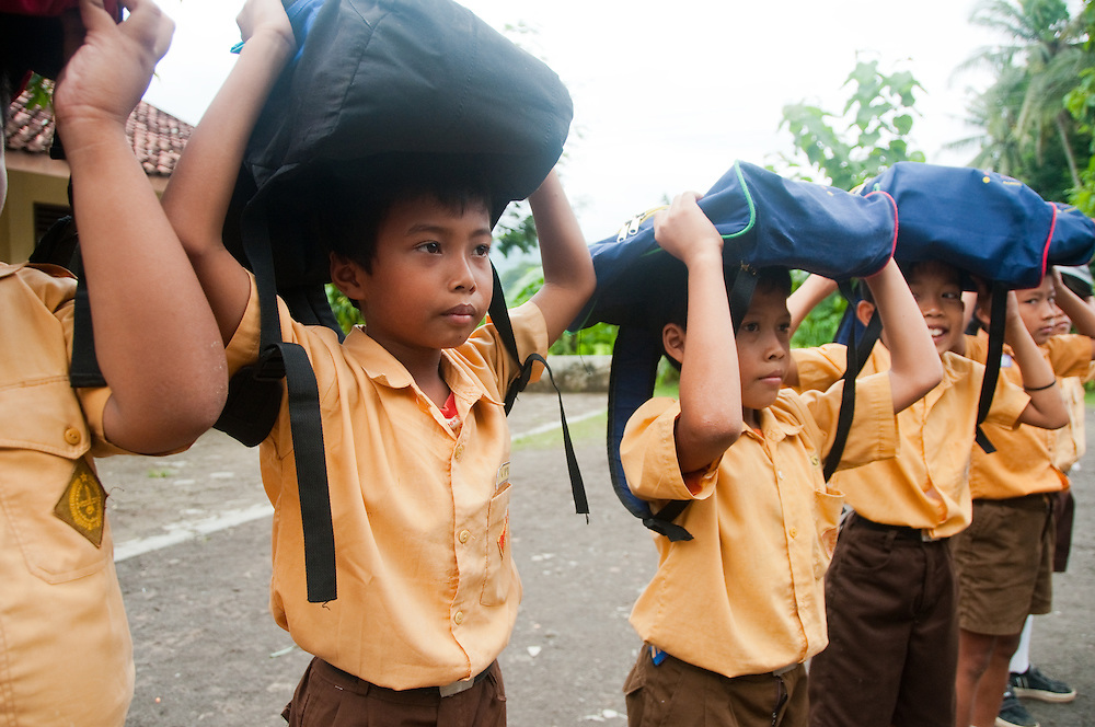 Indonesia, southern Java. In villages that are vulnerable to muddslides school children plan evacuation routes and safety drills for the whole community.