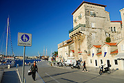 "Waterfront, with sign showing Mother and child pedestrians stating it is a ""Pedestrian Zone"" (Pjesacka Zona). Trogir, Croatia"