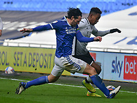 Football - 2020 / 2021 Sky Bet Championship - Cardiff City vs Swansea City - Cardiff City Stadium<br /> <br /> Jamal Lowe of Swansea on the attack challenged by Sean Morrison of Cardiff City in a stadium without fans because of the pandemic crisis<br /> <br /> COLORSPORT/WINSTON BYNORTH