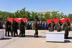 Turkish soldiers carry coffins of helicopter crash victims on June 1, 2017, in the southeastern city of Sirnak. Thirteen Turkish soldiers were killed on May 31, 2017 when a military helicopter crashed after hitting a high-voltage power line in the southeast of the country, the army said. The AS532 Cougar helicopter crashed shortly after taking off from a base in Sirnak province bordering Iraq, killing all 13 onboard, it said in a statement. Sirnak, Turkey, on June 01, 2017. Photo by Sekvan Kuden/Dha/Depo Photos/ABACAPRESS.COM