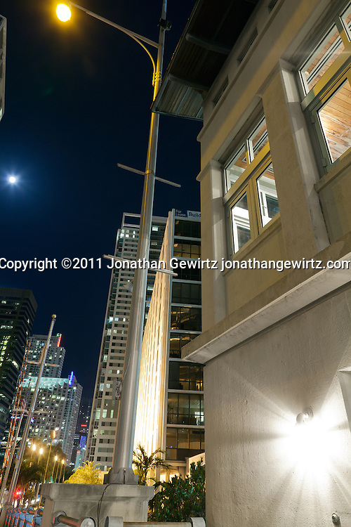 Night view looking South from the Brickell Avenue drawbridge over the Miami River, with condo and office buildings. WATERMARKS WILL NOT APPEAR ON PRINTS OR LICENSED IMAGES.