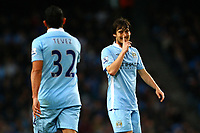 Football - Premier League - Manchester City vs. West Bromwich Albion<br /> David Silva of Manchester City signals to Carlos Tevez at the Etihad Stadium