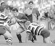 Bath, West Somerset. Great Britain.  Will CARLING, Breaking through, Andy ROBINSON's tackle during the Bath Rugby vs Harlequins, The Recreation Ground [Rec]. 10.09.1988.<br /> <br /> [Mandatory Credit, Peter Spurrier/ Intersport Images].