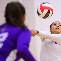 092314       Cable Hoover<br /> <br /> Miyamura Patriot Valynn Nez (1) bumps the ball back to the Grants Pirates Tuesday at Grants High School.