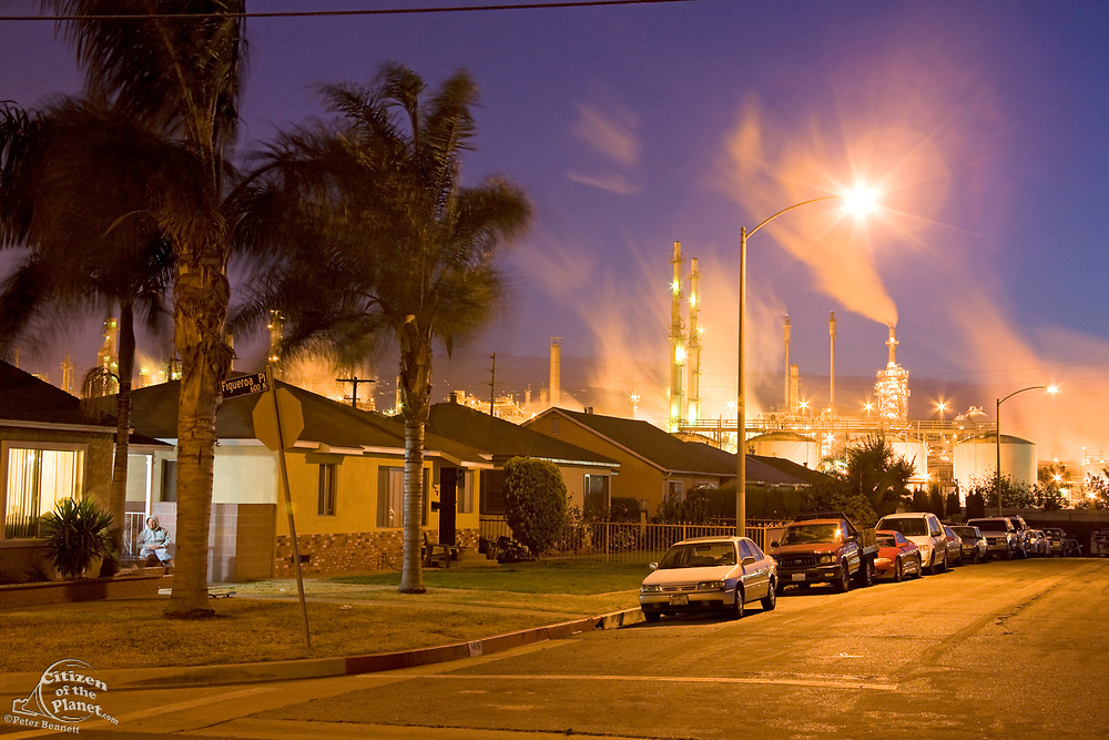 Residential houses next to oil refinery at Wilmington. Wilmington has one the highest risks of cancer due to it's proximity to the Port of Los Angeles at Long Beach, and the several oil refineries in the vicinity. Los Angeles, California, USA