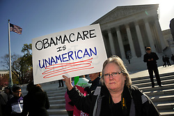 March 27, 2012 - Washington, DC, U.S. - Protestors supporting and opposed to President Obama's health care reform - or ''Obamacare'' - gather outside the U.S. Supreme Court on the second day of oral arguments in lawsuits over the law. (Credit Image: © Jay Mallin/ZUMAPRESS.com)