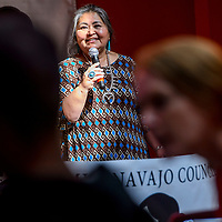 Sunny Dooley welcomes participants to the Miss Navajo Council elemental talks and dialogues forum at the Navajo Department of Education in Window Rock Monday.