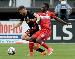May 20, 2017 - Washington, DC, USA - 20170520 - D.C. United defender CHRIS KORB (22) and Chicago Fire midfielder DAVID ACCAM (11) battle for the ball in the second half at RFK Stadium in Washington. (Credit Image: © Chuck Myers via ZUMA Wire)