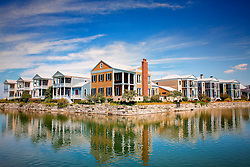 The main focus of the New Town at St. Charles  project was the creation of lakes and canals primarily needed to contain 75 acres of storm runoff. However, these lakes quickly became the strong and indentifiable character of New Town St. Charles by providing it with a dramatic and active waterfront. Four neighborhoods will surround a dense, island-like town center neighborhood connected by greens and plazas and entirely surrounded by water.