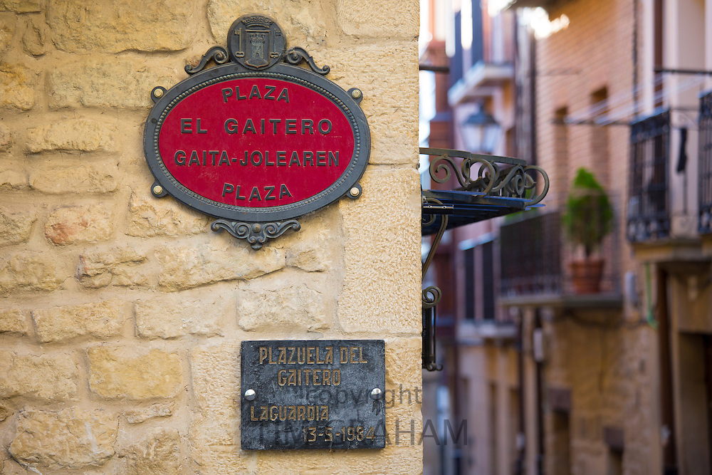 Street signs in Spanish and Euskera Basque language in central square of Basque town of Laguardia in Rioja-Alavesa area of Spain