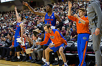 Members of the Florida Gators bench react after a teammate hit a three pointer against Texas A&M during the second half of an NCAA college basketball game Tuesday, Jan. 2, 2018, in College Station, Texas. (AP Photo/Sam Craft)